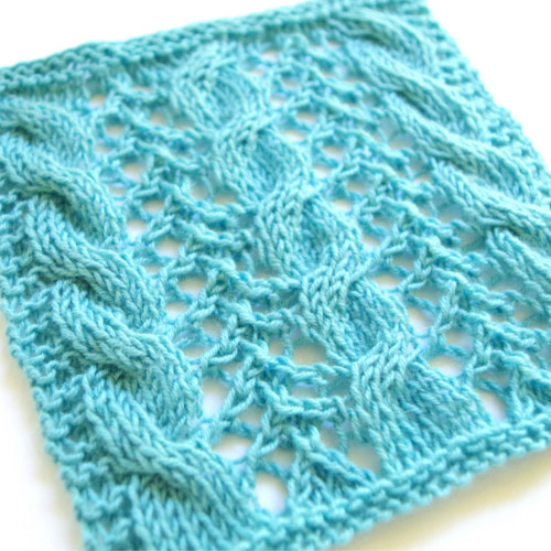 Lace knitting pattern with cables