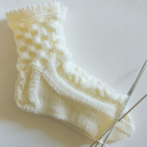 Knitted socks with cables