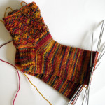 Knitted socks with diagonal ribbing