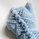knit fingerless gloves with lace and cable pattern