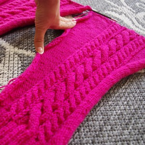 Knitting my cabled sweater sleeves
