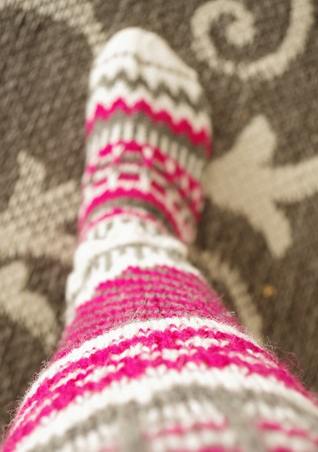 Hand knitted and very colorful fair isle socks