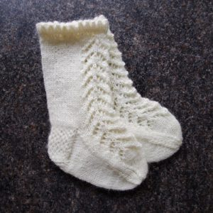 Knitted lace socks for baby