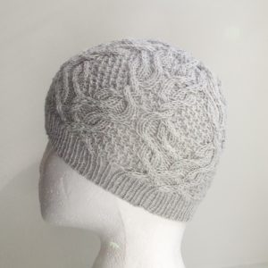 "Knitting pattern review for a cabled hat ""Father Cables"""